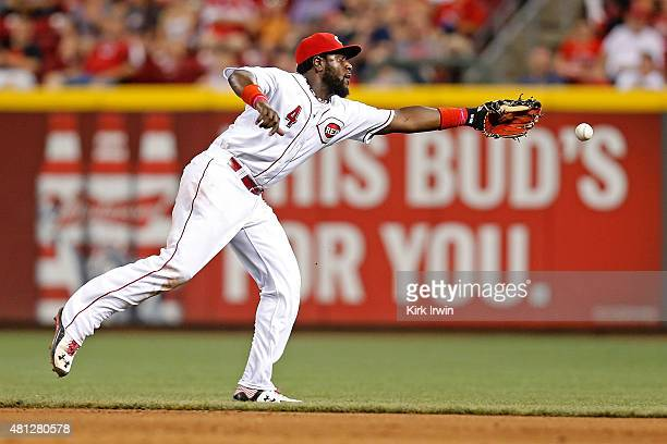 Brandon Phillips of the Cincinnati Reds is unable to field a ground ball hit by Jason Kipnis of the Cleveland Indians in the top of the eighth inning...