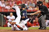 Brandon Phillips of the Cincinnati Reds lies in the dirt after falling down avoiding a pitch against the Milwaukee Brewers in the eighth inning at...