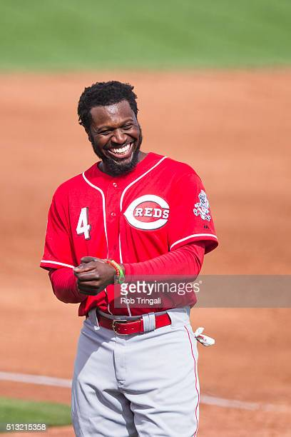 Brandon Phillips of the Cincinnati Reds looks on during a spring training game against the Cleveland Indians at Goodyear Ballpark on March 1 2016 in...