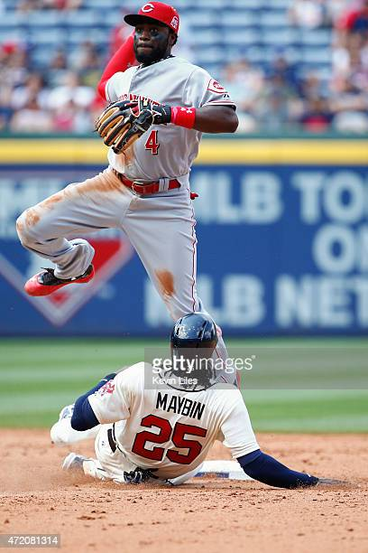 Brandon Phillips of the Cincinnati Reds makes a double play at second as Cameron Maybin of the Atlanta Braves slides during the sixth inning at...
