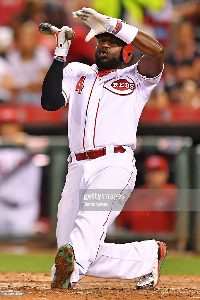 Brandon Phillips #4 of the Cincinnati Reds over rotates on his swing for a strike in the sixth inning against the Milwaukee Brewers at Great American Ball Park on September 12, 2016 in Cincinnati, Ohio. Cincinnati defeated Milwaukee 3-0.