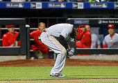 Brandon Phillips of the Cincinnati Reds reacts after being hit with a pitch in the fourth inning against the New York Mets at Citi Field on April 25...