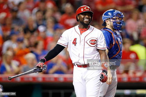 Brandon Phillips of the Cincinnati Reds reacts after striking out in the third inning against the New York Mets at Great American Ball Park on...