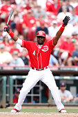 Brandon Phillips of the Cincinnati Reds reacts after taking a pitch inside in the eighth inning of the game against the St Louis Cardinals at Great...