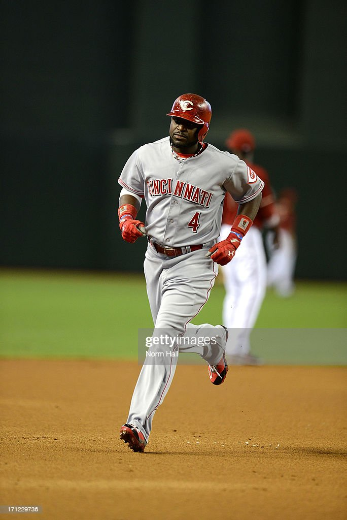 Brandon Phillips #4 of the Cincinnati Reds rounds the bases after hitting a home run against the Arizona Diamondbacks at Chase Field on June 23, 2013 in Phoenix, Arizona.