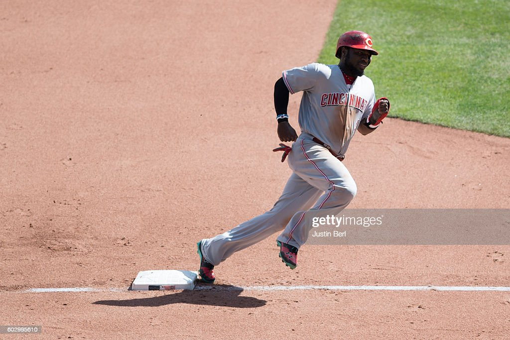 Brandon Phillips #4 of the Cincinnati Reds rounds third base as he heads towards home plate on an RBI double by Ramon Cabrera #37 in the fifth inning during the game against the Pittsburgh Pirates at PNC Park on September 11, 2016 in Pittsburgh, Pennsylvania.