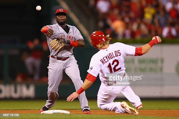 Brandon Phillips of the Cincinnati Reds runs a double play over Mark Reynolds in the fourth inning at Busch Stadium on September 23 2015 in St Louis...