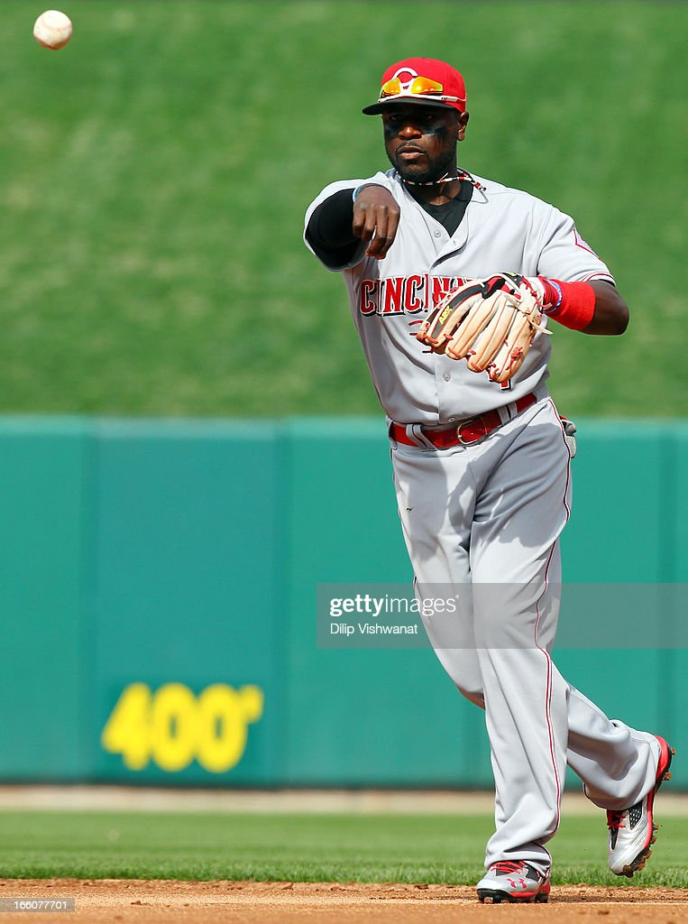 Brandon Phillips #4 of the Cincinnati Reds sends the ball to first against the St. Louis Cardinals during Opening Day on April 8, 2013 at Busch Stadium in St. Louis, Missouri.