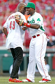 Brandon Phillips of the Cincinnati Reds shakes hands with Bernard Hopkins after he threw out the first pitch prior to the start of the game against...
