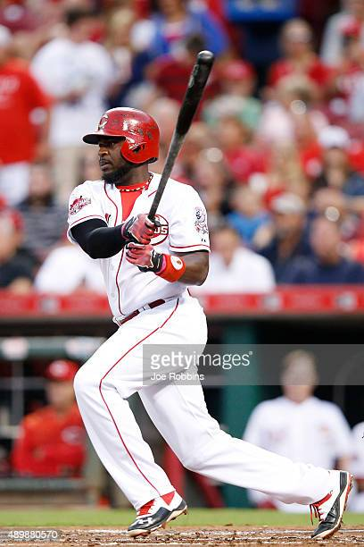 Brandon Phillips of the Cincinnati Reds singles to drive in a run in the first inning against the New York Mets at Great American Ball Park on...