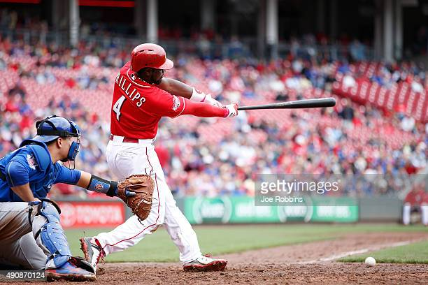 Brandon Phillips of the Cincinnati Reds singles to left center to drive in a run against the Chicago Cubs in the seventh inning at Great American...