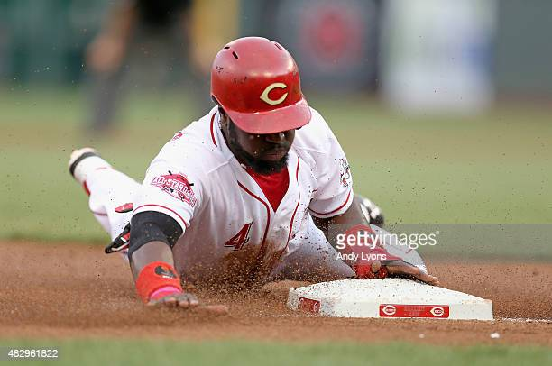 Brandon Phillips of the Cincinnati Reds slides safely into third base for a stolen base in the second inning against the St Louis Cardinals at Great...
