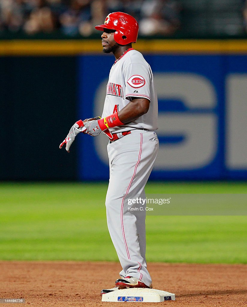 Brandon Phillips #4 of the Cincinnati Reds stands on second base after hitting a RBI double in the eighth inning against the Atlanta Braves at Turner Field on May 14, 2012 in Atlanta, Georgia.
