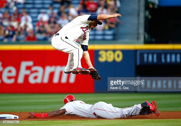 Brandon Phillips of the Cincinnati Reds steals second base safely under Jace Peterson of the Atlanta Braves in the fourth inning at Turner Field on...