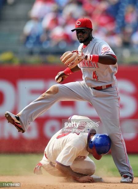 Brandon Phillips of the Cincinnati Reds steps over Raul Ibanez of the Philadelphia Phillies on an attempted double play at Citizens Bank Park on May...