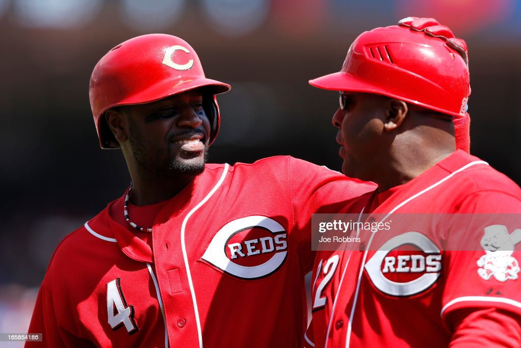 Brandon Phillips #4 of the Cincinnati Reds talks with first base coach Billy Hatcher during the game against the Washington Nationals at Great American Ball Park on April 6, 2013 in Cincinnati, Ohio. The Nationals won 7-6 in 11 innings.