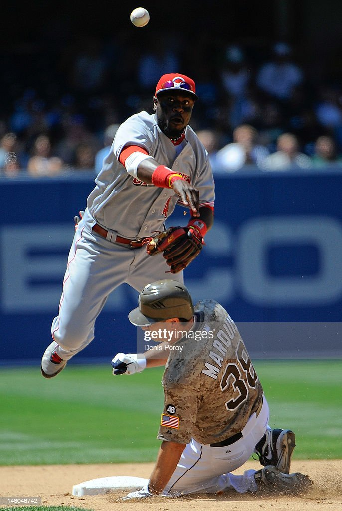 Brandon Phillips #4 of the Cincinnati Reds throws over <a gi-track='captionPersonalityLinkClicked' href=/galleries/search?phrase=Jason+Marquis&family=editorial&specificpeople=210770 ng-click='$event.stopPropagation()'>Jason Marquis</a> #38 of the San Diego Padres as he tries to turn a double play during the fifth inning of a baseball game at Petco Park on July 8, 2012 in San Diego, California.