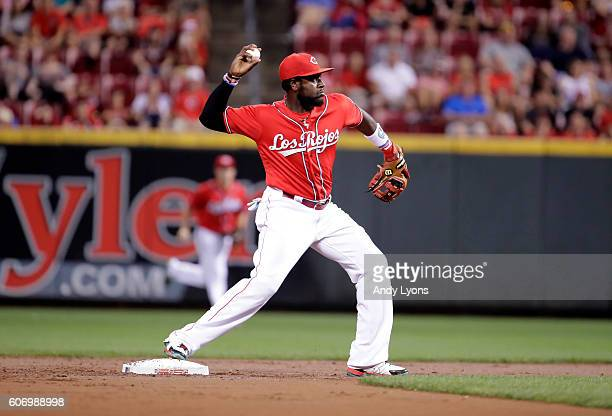 Brandon Phillips of the Cincinnati Reds throws the ball to firstbase to complete a double play in the first inning against the Pittsburgh Pirates at...