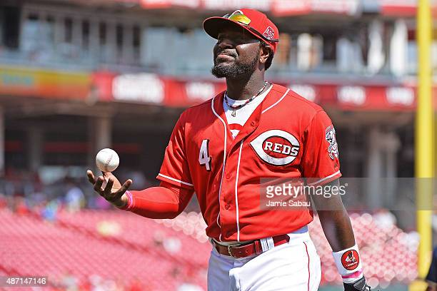 Brandon Phillips of the Cincinnati Reds walks to the dugout after making a fly ball catch to end the top of the fourth inning against the Milwaukee...