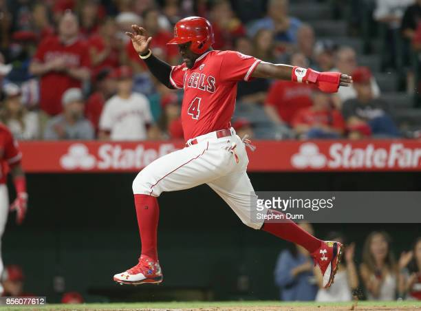 Brandon Phillips of the Los Angeles Angels of Anaheim scores a run on a sacrifice fly by Luis Valbuena in the fourth inning against the Seattle...