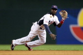 Brandon Phillips of the United States field a ground ball for an out in the third inning hit by Karim Garcia of Mexico during the World Baseball...