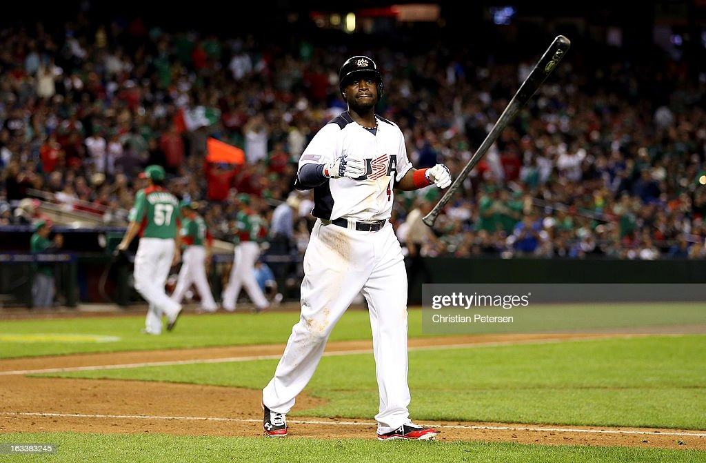 Brandon Phillips #4 of the United States tosses his bat as he reacts after he struck out in the bottom of the seventh inning against Mexico during the World Baseball Classic First Round Group D game at Chase Field on March 8, 2013 in Phoenix, Arizona.