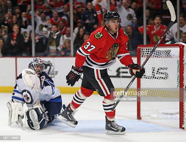 Brandon Pirri of the Chicago Blackhawks celebrates his second period goal as he skates past Al Montoya of the Winnipeg Jets at the United Center on...