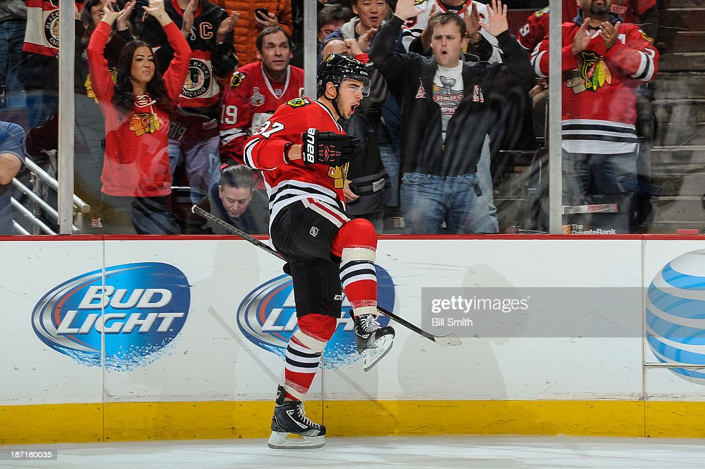 <a gi-track='captionPersonalityLinkClicked' href=/galleries/search?phrase=Brandon+Pirri&family=editorial&specificpeople=5894589 ng-click='$event.stopPropagation()'>Brandon Pirri</a> #37 of the Chicago Blackhawks reacts after scoring against the Winnipeg Jets in the second period during the NHL game on November 06, 2013 at the United Center in Chicago, Illinois.