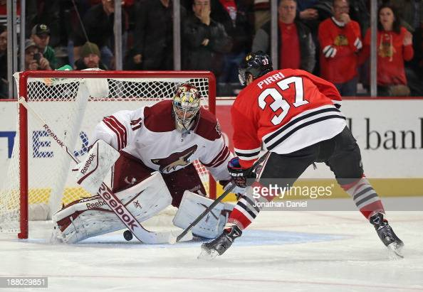 Brandon Pirri of the Chicago Blackhawks scores the gamewinning goal against Mike Smith of the Phoenix Coyotes at the United Center on November 14...