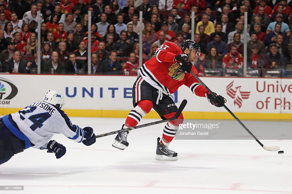 <a gi-track='captionPersonalityLinkClicked' href=/galleries/search?phrase=Brandon+Pirri&family=editorial&specificpeople=5894589 ng-click='$event.stopPropagation()'>Brandon Pirri</a> #37 of the Chicago Blackhawks shoots and scores a goal under pressure from <a gi-track='captionPersonalityLinkClicked' href=/galleries/search?phrase=Grant+Clitsome&family=editorial&specificpeople=4596638 ng-click='$event.stopPropagation()'>Grant Clitsome</a> #24 of the Winnipeg Jets at the United Center on November 6, 2013 in Chicago, Illinois.