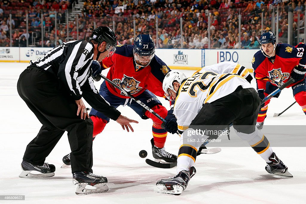 Brandon Pirri of the Florida Panthers faces off against Chris Kelly of the Boston Bruins at the BBT Center on October 30 2015 in Sunrise Florida