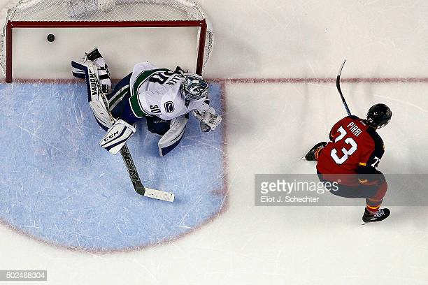Brandon Pirri of the Florida Panthers scores in a shootout against Goaltender Ryan Miller of the Vancouver Canucks at the BBT Center on December 20...