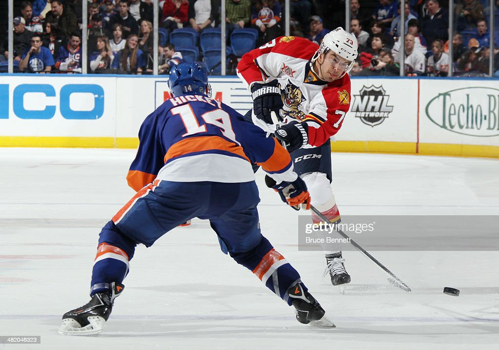 Brandon Pirri #73 of the Florida Panthers skates against the New York Islanders at the Nassau Veterans Memorial Coliseum on April 1, 2014 in Uniondale, New York. The Islanders defeated the Panthers 4-2.