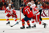 Brandon Pirri of the Florida Panthers skates for possession against Henrik Zetterberg of the Detroit Red Wings at the BBT Center on March 19 2015 in...