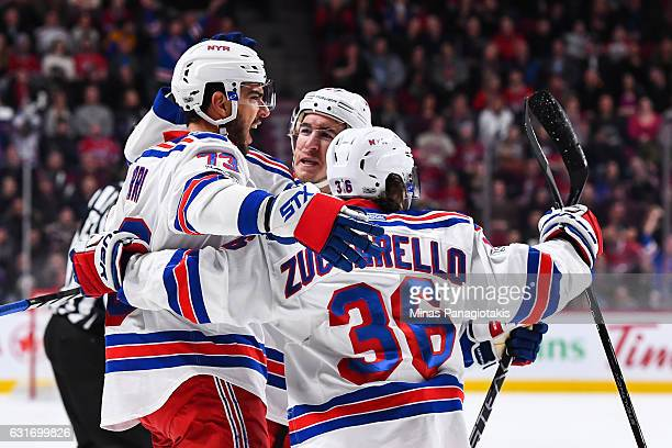 Brandon Pirri of the New York Rangers celebrates a first period goal with teammates during the NHL game against the Montreal Canadiens at the Bell...