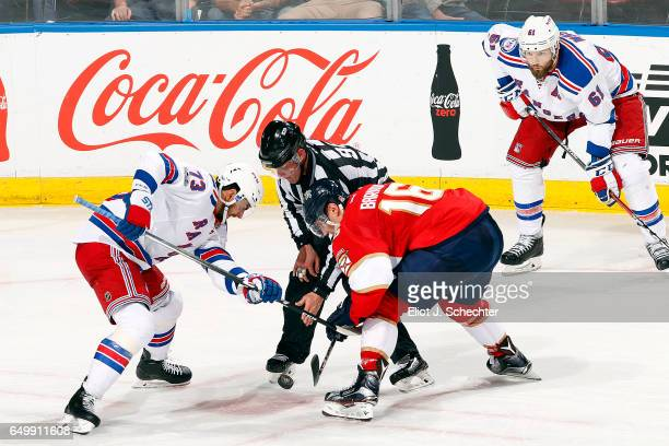 Brandon Pirri of the New York Rangers faces off against Aleksander Barkov of the Florida Panthers at the BBT Center on March 7 2017 in Sunrise Florida