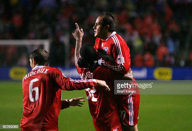 Brandon Prideaux Dasan Robinson and Cuauhtemoc Blanco of the Chicago Fire celebrate after Chivas USA scored an own goal after a Blanco corner kick...