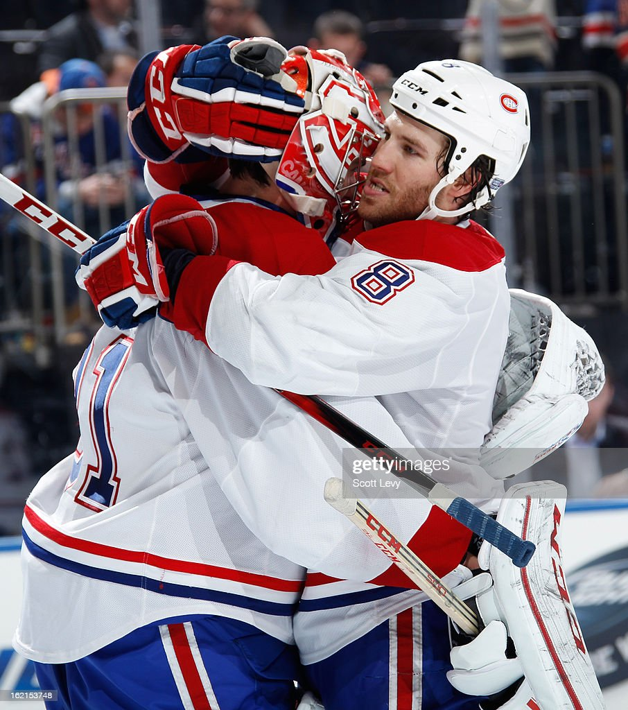 <a gi-track='captionPersonalityLinkClicked' href=/galleries/search?phrase=Brandon+Prust&family=editorial&specificpeople=2221796 ng-click='$event.stopPropagation()'>Brandon Prust</a> #8 and Carey Price #31 of the Montreal Canadiens celebrate the win against the New York Rangers at Madison Square Garden on February 19, 2013 in New York City. The Canadiens defeat the Rangers 3-1.
