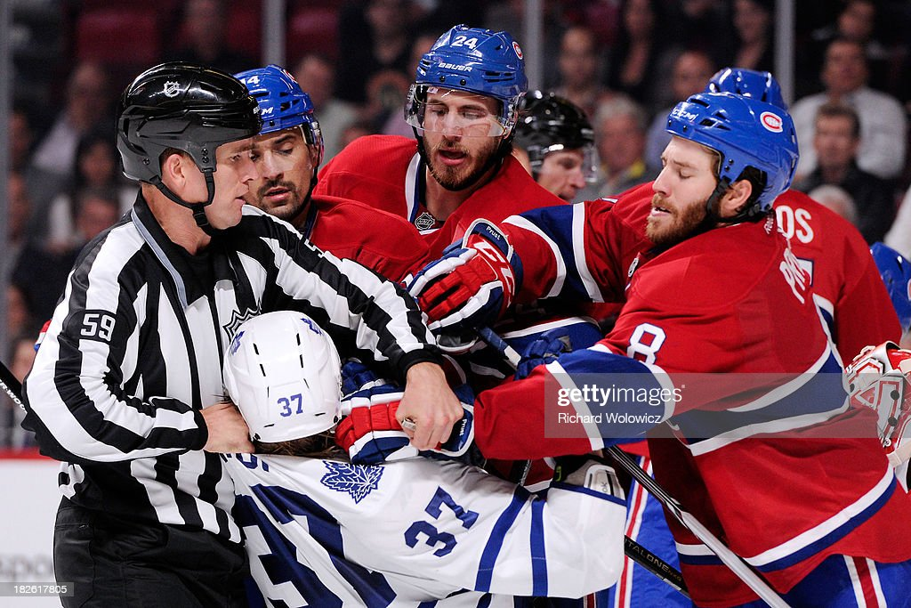 <a gi-track='captionPersonalityLinkClicked' href=/galleries/search?phrase=Brandon+Prust&family=editorial&specificpeople=2221796 ng-click='$event.stopPropagation()'>Brandon Prust</a> #8 and <a gi-track='captionPersonalityLinkClicked' href=/galleries/search?phrase=Jarred+Tinordi&family=editorial&specificpeople=7029368 ng-click='$event.stopPropagation()'>Jarred Tinordi</a> #24 of the Montreal Canadiens mix it up with <a gi-track='captionPersonalityLinkClicked' href=/galleries/search?phrase=Carter+Ashton&family=editorial&specificpeople=4779660 ng-click='$event.stopPropagation()'>Carter Ashton</a> #37 of the Toronto Maple Leafs during the NHL game at the Bell Centre on October 1, 2013 in Montreal, Quebec, Canada. The Maple Leafs defeated the Canadiens 4-3.