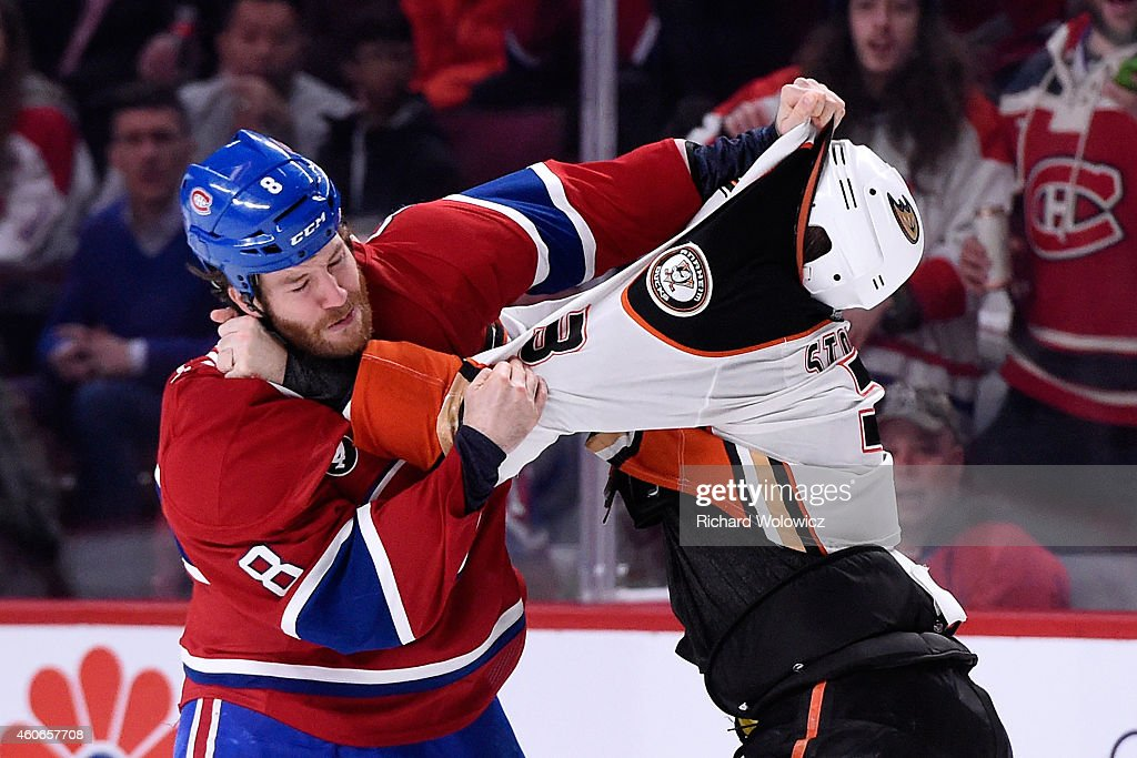 Brandon Prust of the Montreal Canadiens and Clayton Stoner of the Anaheim Ducks fight during the NHL game at the Bell Centre on December 18 2014 in...