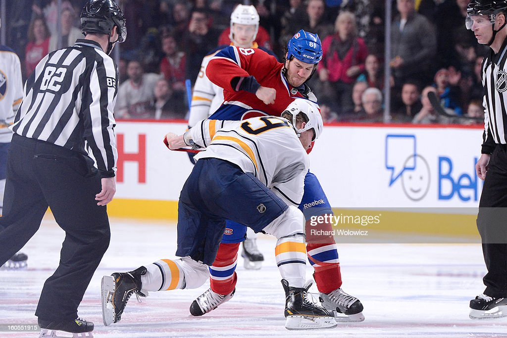 <a gi-track='captionPersonalityLinkClicked' href=/galleries/search?phrase=Brandon+Prust&family=editorial&specificpeople=2221796 ng-click='$event.stopPropagation()'>Brandon Prust</a> #8 of the Montreal Canadiens and <a gi-track='captionPersonalityLinkClicked' href=/galleries/search?phrase=Steve+Ott&family=editorial&specificpeople=210616 ng-click='$event.stopPropagation()'>Steve Ott</a> #9 of the Buffalo Sabres fight during the NHL game at the Bell Centre on February 2, 2013 in Montreal, Quebec, Canada. The Canadiens defeated the Sabres 6-1.