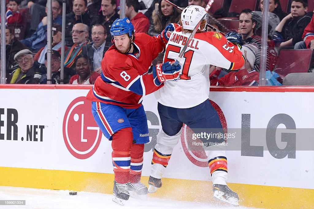 <a gi-track='captionPersonalityLinkClicked' href=/galleries/search?phrase=Brandon+Prust&family=editorial&specificpeople=2221796 ng-click='$event.stopPropagation()'>Brandon Prust</a> #8 of the Montreal Canadiens body checks <a gi-track='captionPersonalityLinkClicked' href=/galleries/search?phrase=Brian+Campbell+-+Ice+Hockey+Player&family=editorial&specificpeople=209384 ng-click='$event.stopPropagation()'>Brian Campbell</a> #51 of the Florida Panthers during the NHL game at the Bell Centre on January 22, 2013 in Montreal, Quebec, Canada. The Canadiens defeated the Panthers 4-1.