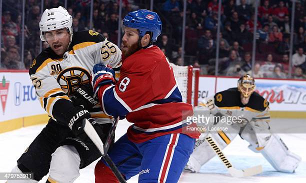 Brandon Prust of the Montreal Canadiens challenges Johnny Boychuk of the Boston Bruins during the NHL game on March 12 2014 at the Bell Centre in...