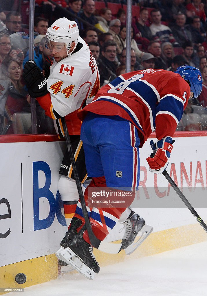 <a gi-track='captionPersonalityLinkClicked' href=/galleries/search?phrase=Brandon+Prust&family=editorial&specificpeople=2221796 ng-click='$event.stopPropagation()'>Brandon Prust</a> #8 of the Montreal Canadiens checks into the boards Chris Butler #44 of the Calgary Flames during the NHL game on February 4, 2014 at the Bell Centre in Montreal, Quebec, Canada.