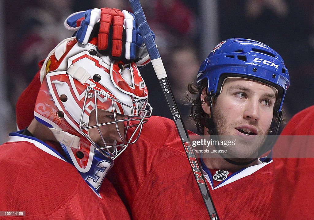 <a gi-track='captionPersonalityLinkClicked' href=/galleries/search?phrase=Brandon+Prust&family=editorial&specificpeople=2221796 ng-click='$event.stopPropagation()'>Brandon Prust</a> #8 (R) of the Montreal Canadiens congratulates goalie <a gi-track='captionPersonalityLinkClicked' href=/galleries/search?phrase=Carey+Price&family=editorial&specificpeople=2222083 ng-click='$event.stopPropagation()'>Carey Price</a> #31 following his NHL shut out victory over the New York Rangers on March 30, 2013 at the Bell Centre in Montreal, Quebec, Canada.