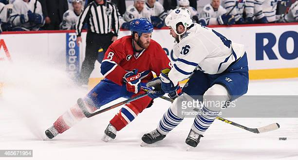 Brandon Prust of the Montreal Canadiens controls the puck against the Toronto Maple Leafs in the NHL game at the Bell Centre on February 28 2015 in...