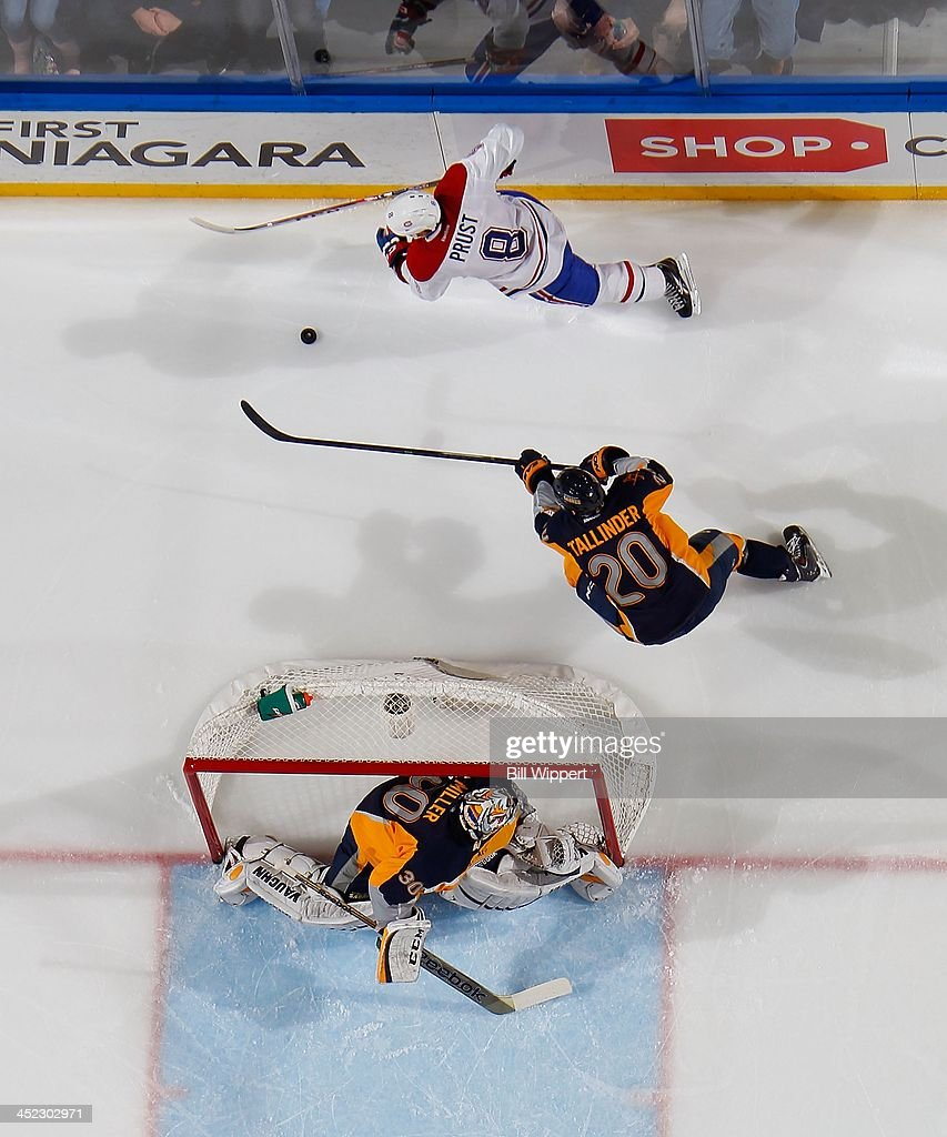 <a gi-track='captionPersonalityLinkClicked' href=/galleries/search?phrase=Brandon+Prust&family=editorial&specificpeople=2221796 ng-click='$event.stopPropagation()'>Brandon Prust</a> #8 of the Montreal Canadiens controls the puck behind the net while being pursued by <a gi-track='captionPersonalityLinkClicked' href=/galleries/search?phrase=Henrik+Tallinder&family=editorial&specificpeople=204661 ng-click='$event.stopPropagation()'>Henrik Tallinder</a> #20 of the Buffalo Sabres on November 27, 2013 at the First Niagara Center in Buffalo, New York.