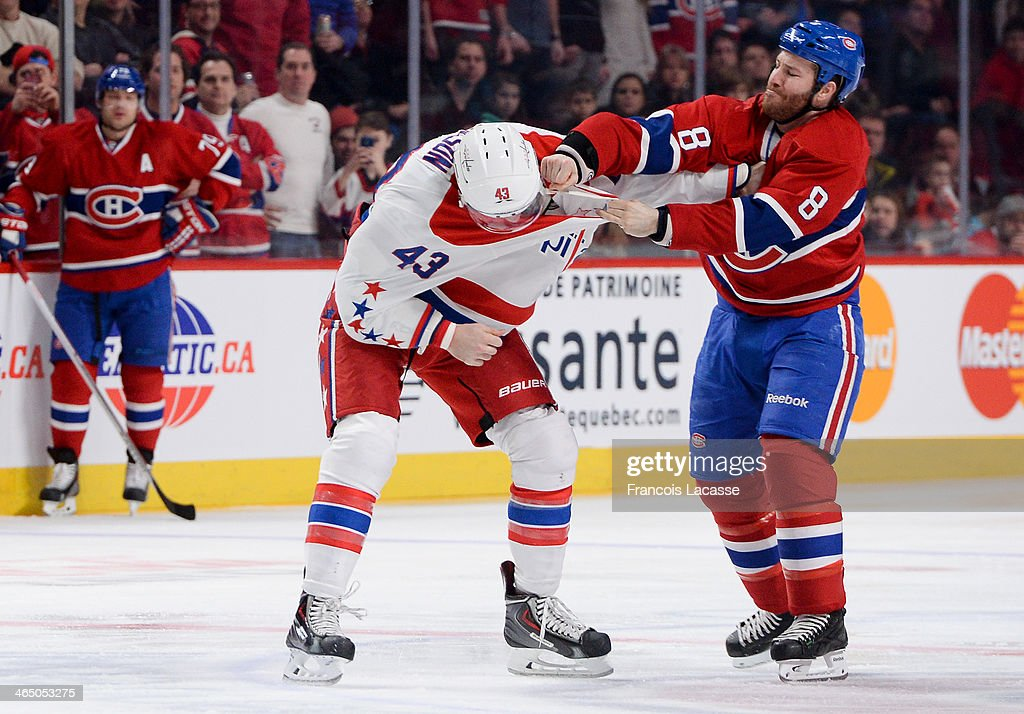 <a gi-track='captionPersonalityLinkClicked' href=/galleries/search?phrase=Brandon+Prust&family=editorial&specificpeople=2221796 ng-click='$event.stopPropagation()'>Brandon Prust</a> #8 of the Montreal Canadiens fights against Tom Wilson #43 of the Washington Capitals during the NHL game on January 25, 2014 at the Bell Centre in Montreal, Quebec, Canada.