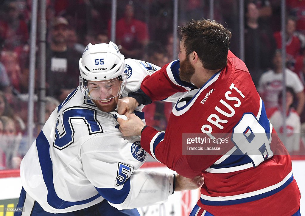 <a gi-track='captionPersonalityLinkClicked' href=/galleries/search?phrase=Brandon+Prust&family=editorial&specificpeople=2221796 ng-click='$event.stopPropagation()'>Brandon Prust</a> #8 of the Montreal Canadiens fights with <a gi-track='captionPersonalityLinkClicked' href=/galleries/search?phrase=Braydon+Coburn&family=editorial&specificpeople=2077063 ng-click='$event.stopPropagation()'>Braydon Coburn</a> #55 of the Tampa Bay Lightning in Game 2 of the Eastern Conference Semifinals during the NHL Stanley Cup Playoffs at the Bell Centre on May 03, 2015 in Montreal, Quebec, Canada.