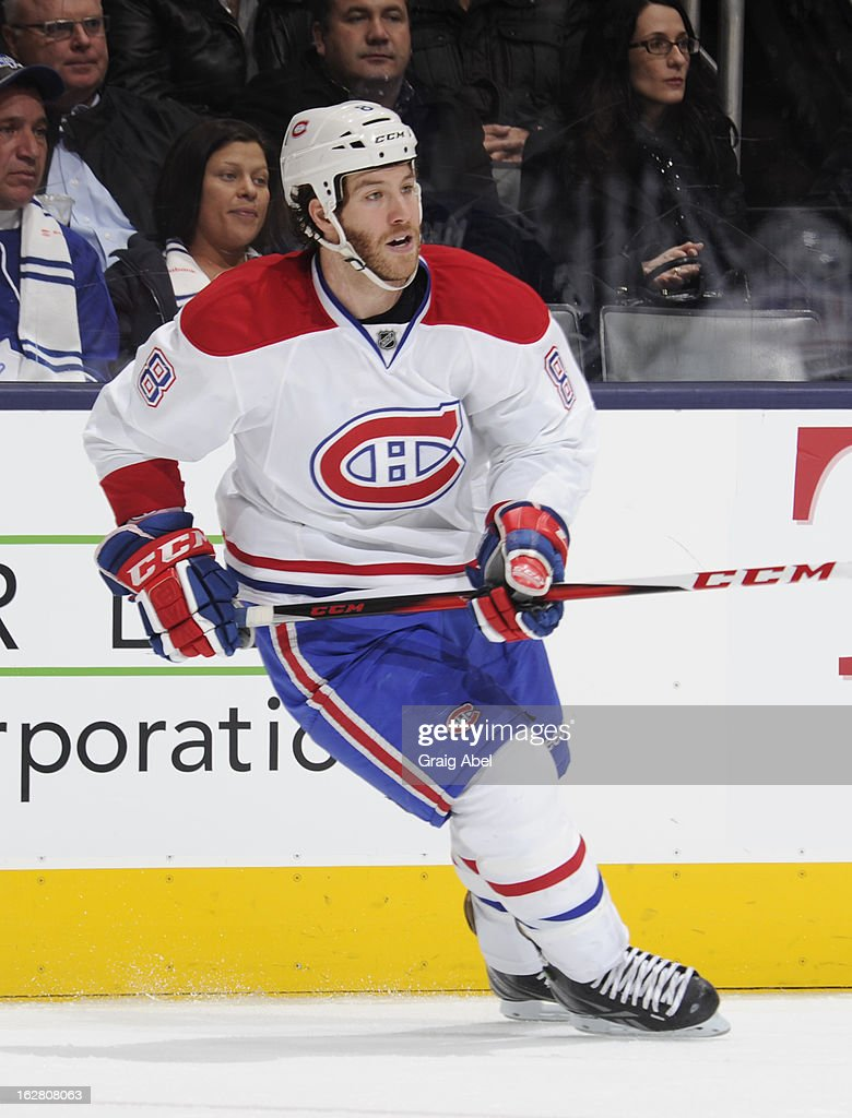 <a gi-track='captionPersonalityLinkClicked' href=/galleries/search?phrase=Brandon+Prust&family=editorial&specificpeople=2221796 ng-click='$event.stopPropagation()'>Brandon Prust</a> #8 of the Montreal Canadiens skates during NHL game action against the Toronto Maple Leafs February 27, 2013 at the Air Canada Centre in Toronto, Ontario, Canada.